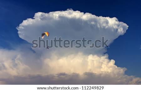 "Flying Around the ""Big Wave"" cloud - stock photo"