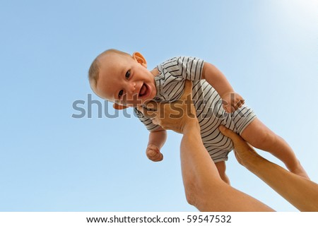 Flying baby. - stock photo