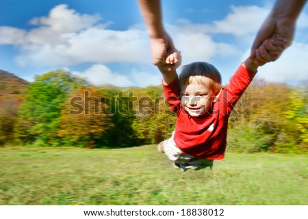 flying baby on autumn forest background - stock photo