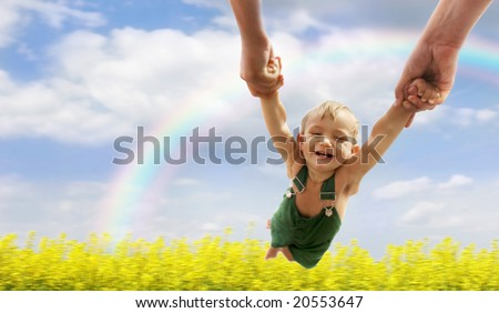 flying baby over natural background