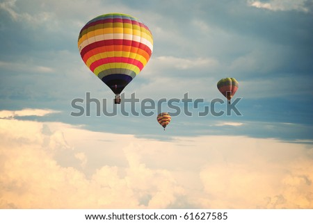 Flying balloon during sunset - stock photo