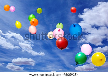 Flying balloons in blue sky with clouds - stock photo