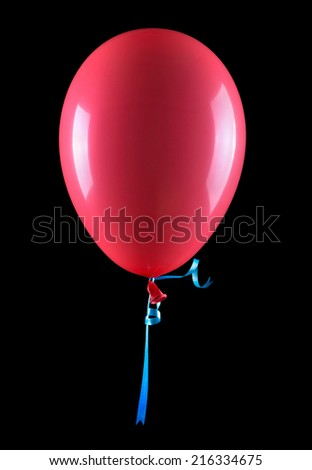 flying balloons isolated on a black background - stock photo