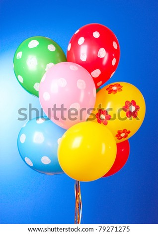 Flying balloons with polka dot on a blue background - stock photo