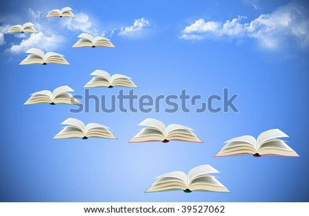 Flying books on gradient blue background with clouds - stock photo