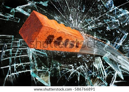 flying brick through broken glass window stock photo 586766891 shutterstock. Black Bedroom Furniture Sets. Home Design Ideas