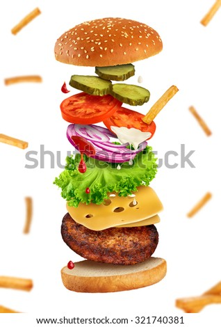 Flying burger ingredients and fri on a white background - stock photo