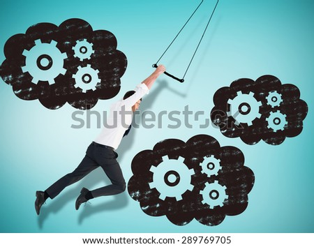 Flying businessman against blue vignette background - stock photo
