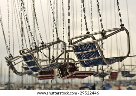 flying chairs in the luna-park - stock photo
