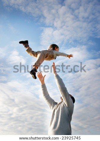 flying child on sky background