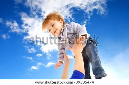 flying child on sky background - stock photo