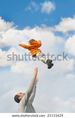 flying child over sky background - stock photo