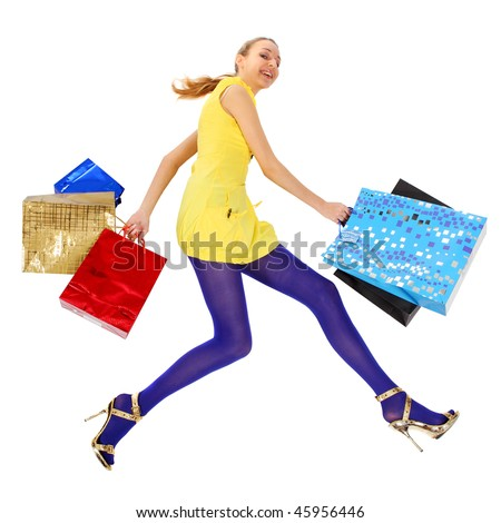 Flying crazy shopping. Happy girl with Shopping Bags. - stock photo