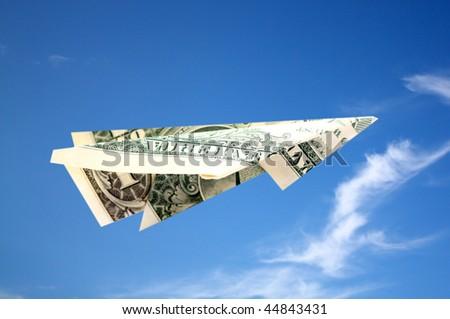 Flying dollar plane - stock photo