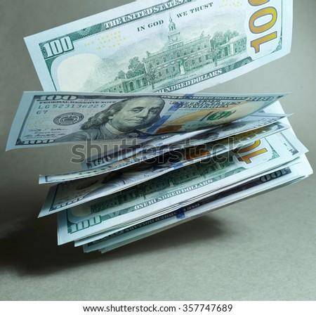 flying dollars - stock photo