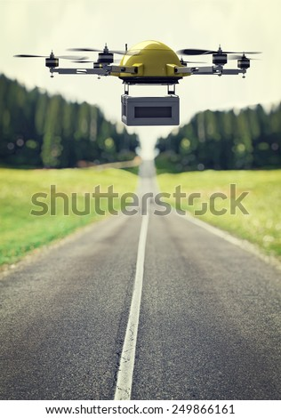 flying drone and lonely road - stock photo