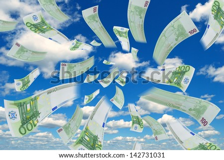 Flying euro banknotes against the sky. - stock photo