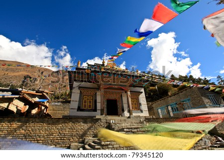 Flying flags over a temple - stock photo