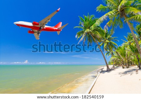Flying for tropical holidays  - stock photo
