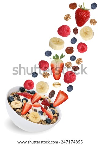 Flying fruit muesli with fruits like raspberry, blueberries, banana and strawberry