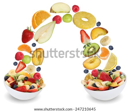 Flying fruit salad in bowl with fruits like apples, oranges, kiwi, grapes, peach, banana and strawberry - stock photo