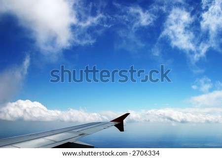 Flying high in the sky - stock photo