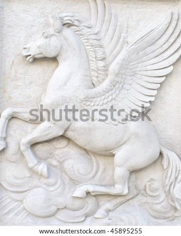 Flying horse figure. - stock photo
