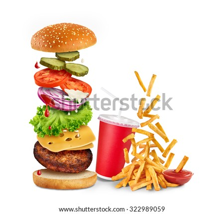 Flying ingredients of hamburger, fried potatoes, ketchup and paper cup isolated on white background. - stock photo