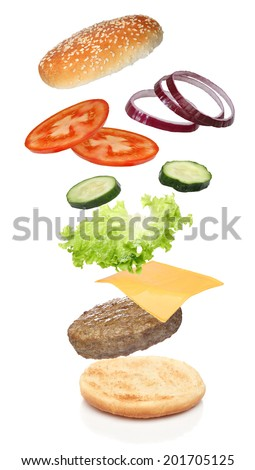 Flying ingredients of hamburger isolated on white