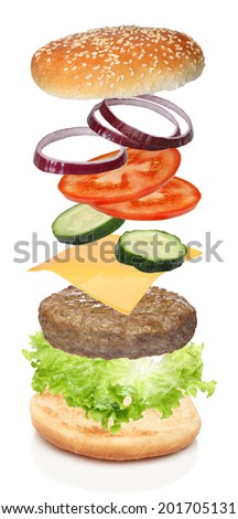 Flying ingredients of hamburger isolated on white - stock photo
