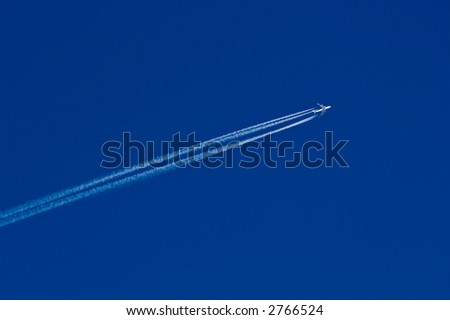 flying jet airplane on blue sky background