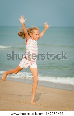 flying jumping beach girl at blue sea shore in summer vacation in the day time