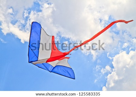 flying kite in the air against the blue sky - stock photo