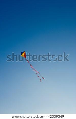 Flying kite in the blue sky - stock photo
