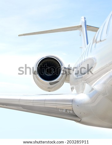 Flying luxury private aircraft. Jet Engine with a part of a wing - stock photo