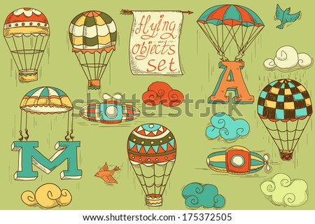 flying objects set with hot air balloons, parachute, airships, clouds, birds, letters A and M, colored in green background, vintage hand-drawn icons  - stock photo