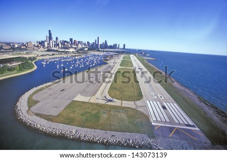 Flying over Meigs Airport Landing Strip, Chicago, Illinois - stock photo