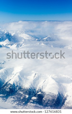 Flying over the Alps - stock photo