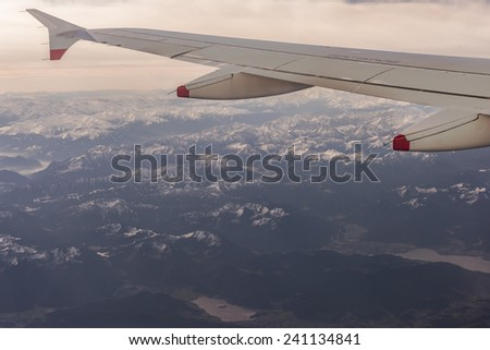 Flying Over the Austrian Alps - stock photo