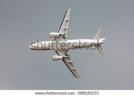 Flying plane - stock photo