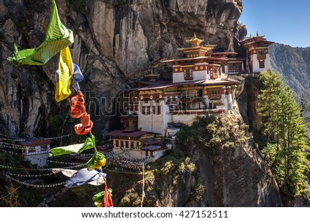 Flying prayer flags at Paro Taktsang. Known as Tiger's Nest, it is a prominent Buddhist sacred site in Bhutan.