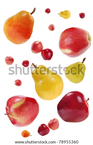flying red apples and colorful pears on white  background - stock photo