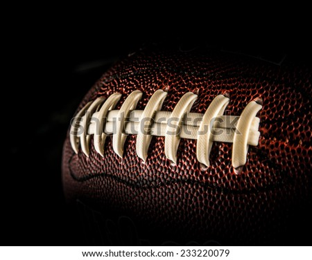 flying rugby ball isolated on black. - stock photo