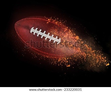 flying rugby ball with dirt isolated on black. - stock photo