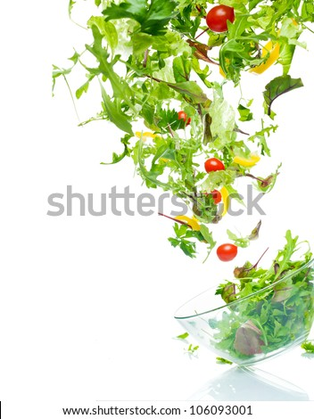 Flying salad. Isolated over white. Shallow dof