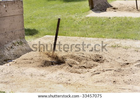 Flying sand as the Horseshoe ringer is made. - stock photo