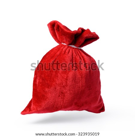Flying Santa Claus red bag full, on white background. File contains a path to isolation. - stock photo