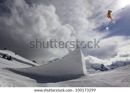 flying skier on mountains, big air - stock photo