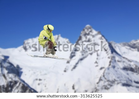 Flying skier on mountains, extreme sport - stock photo