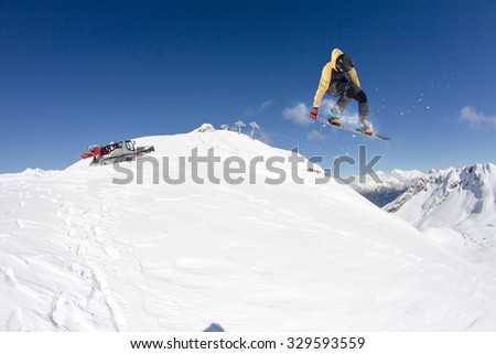 Flying skier on mountains, winter extreme sport - stock photo